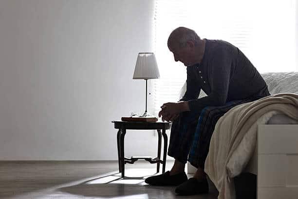 paziente seduto sul letto